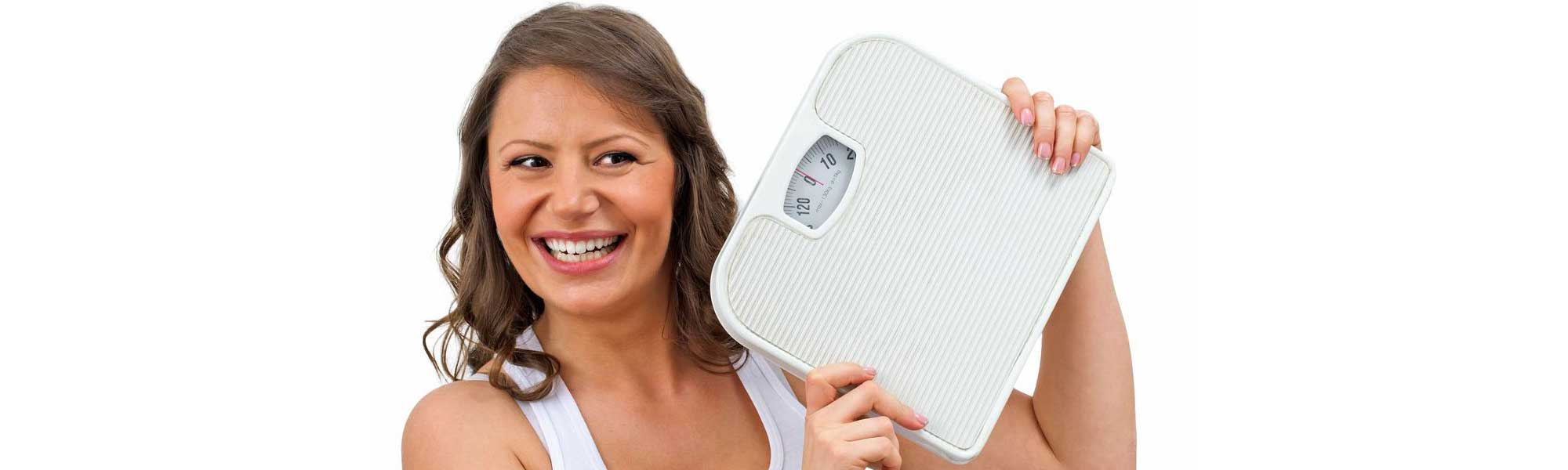 Woman Smiling with Bathroom Scale